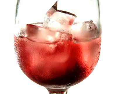 stock-footage-ice-cubes-melting-in-glass-of-red-drink